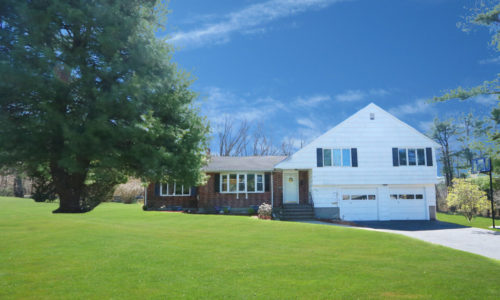 Front Exterior Photograph of 40 Lyons Drive in Westwood MA