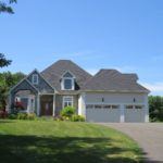 Front Exterior Photograph of 82 Country Club Road in Dedham MA