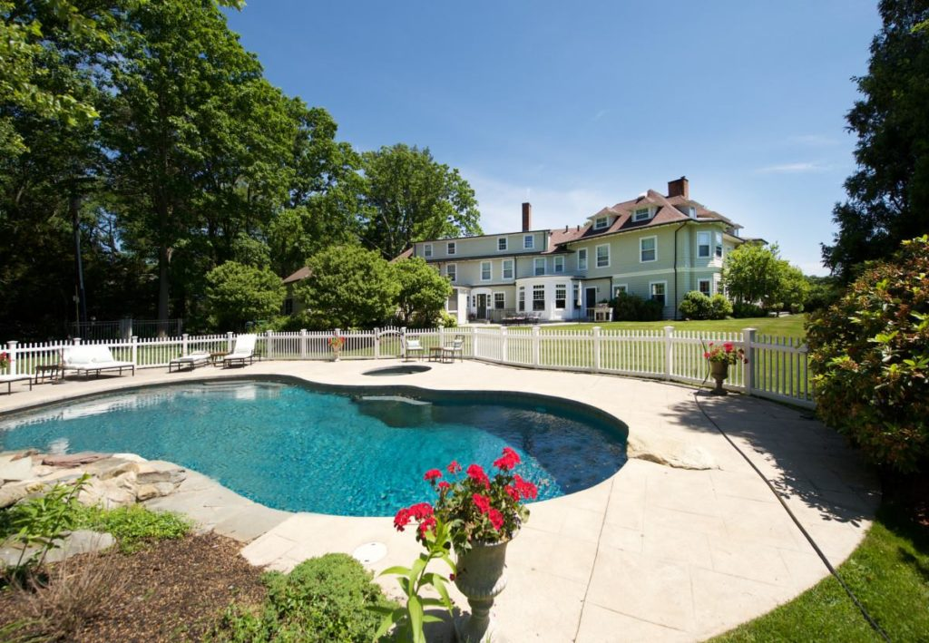 Back exterior image of pool and 665 clapboardtree street in westwood ma